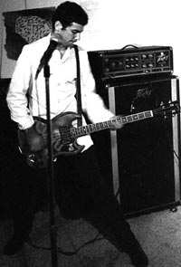 Mike Watt in 1979 with his split headstock Gibson EB3 - playing with The Reactionaries