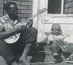 Ralphe Armstrong as a child, with his father Howard